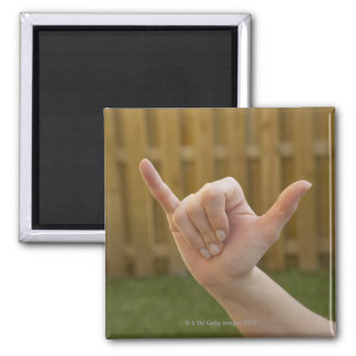 Close-up of a woman's hand making a shaka sign 2 inch square magnet