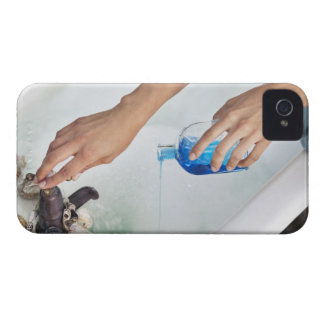 Close-up of a woman's hand pouring aromatherapy iPhone 4 case