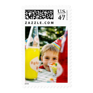 Close-up of a young boy (4-6) at a birthday postage