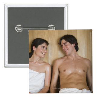 Close-up of a young couple sitting in a sauna button