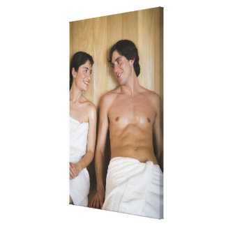 Close-up of a young couple sitting in a sauna canvas print