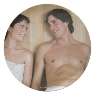 Close-up of a young couple sitting in a sauna dinner plate