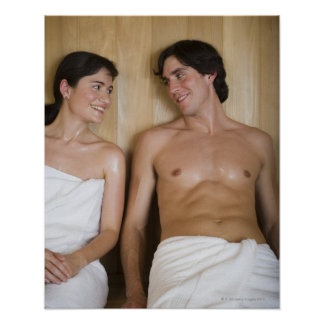 Close-up of a young couple sitting in a sauna poster