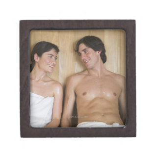 Close-up of a young couple sitting in a sauna premium jewelry boxes