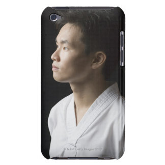 Close-up of a young man contemplating barely there iPod case