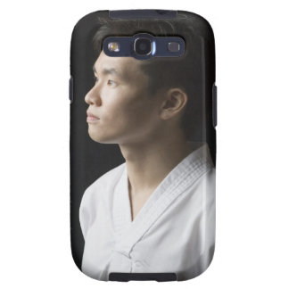 Close-up of a young man contemplating samsung galaxy SIII cases