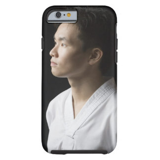 Close-up of a young man contemplating tough iPhone 6 case