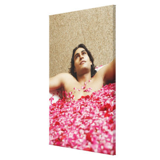 Close-up of a young man lying in a bathtub canvas prints