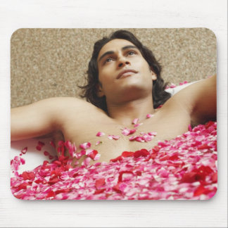 Close-up of a young man lying in a bathtub mouse pad