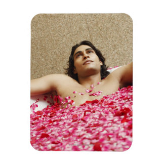 Close-up of a young man lying in a bathtub rectangular photo magnet