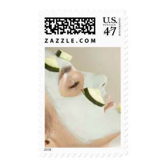 Close-up of a young woman wearing a facial mask postage stamp