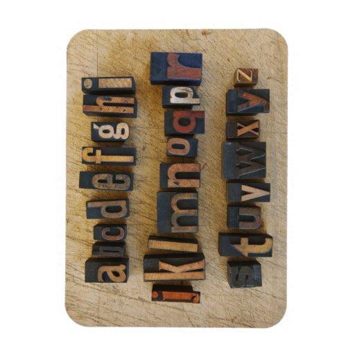 Close up of alphabet on letterpress rectangular photo magnet
