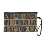 Close up of alphabet on letterpress wristlet purse