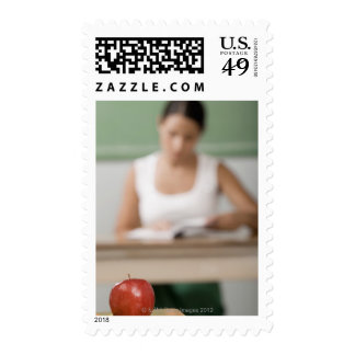 Close-up of an apple on a desk postage stamps