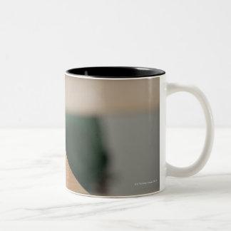 Close-up of an apple on a desk Two-Tone coffee mug