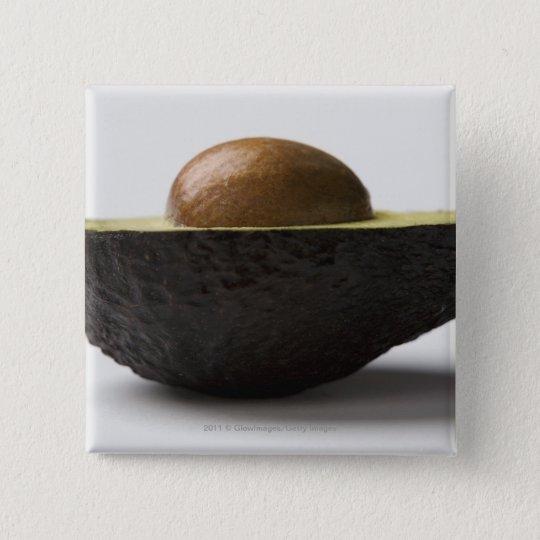 Close-up of an avocado pinback button