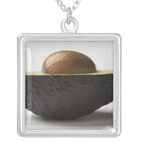 Close-up of an avocado silver plated necklace