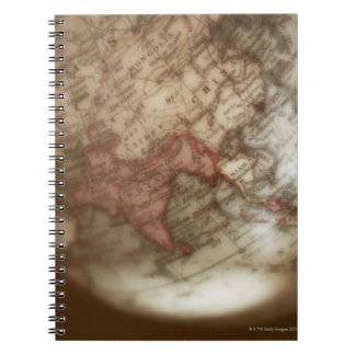 Close up of antique globe 2 notebook