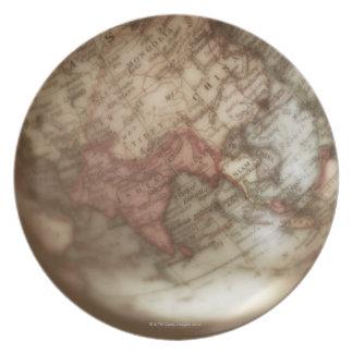 Close up of antique globe 2 plates
