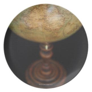 Close-up of antique globe 2 dinner plates