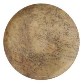 Close up of antique globe 3 plates