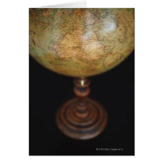 Close-up of antique globe card