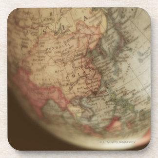Close-up of antique globe drink coaster