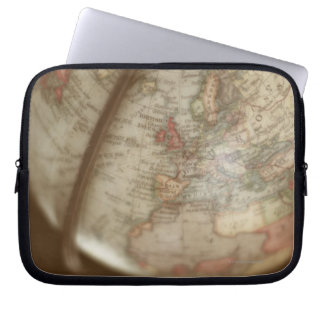 Close up of antique globe laptop sleeves