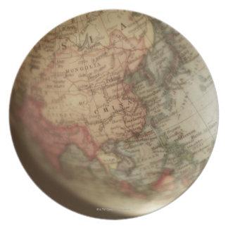 Close-up of antique globe melamine plate