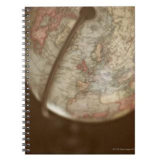 Close up of antique globe note book