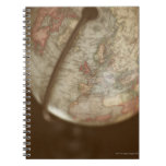 Close up of antique globe notebook