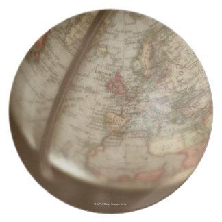 Close up of antique globe plates