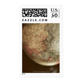 Close-up of antique globe postage