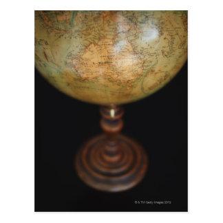 Close-up of antique globe postcard
