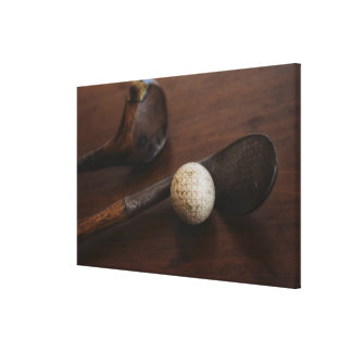 Close up of antique golf clubs and golf ball canvas print