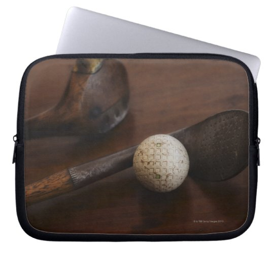 Close up of antique golf clubs and golf ball laptop sleeve