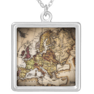 Close up of antique world map 2 necklaces