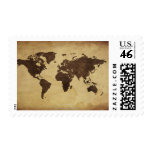 Close up of antique world map 3 postage stamps