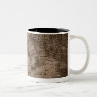 Close up of antique world map 5 coffee mugs