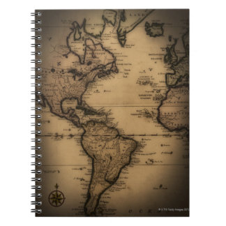 Close up of antique world map note books