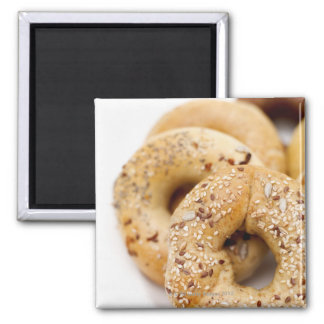 Close-up of assorted bagels on a plate 2 inch square magnet