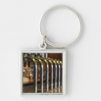 Close-up of bar taps Silver-Colored square keychain