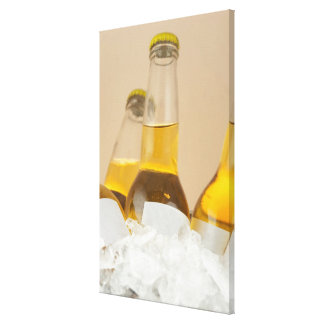 Close-up of beer bottles in ice canvas print