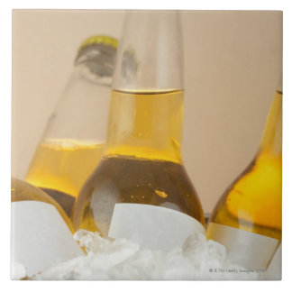 Close-up of beer bottles in ice ceramic tile