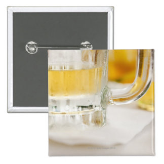Close up of beer in glass pinback button