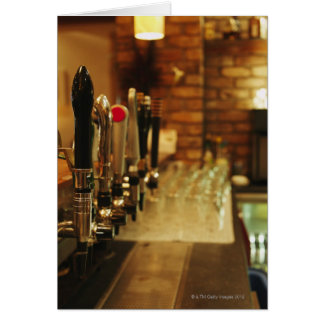Close-up of beer taps in bar 2 card
