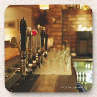 Close-up of beer taps in bar 2 drink coaster