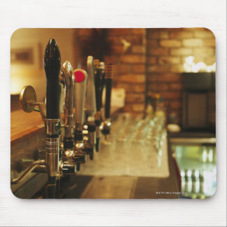 Close-up of beer taps in bar 2 mousepads