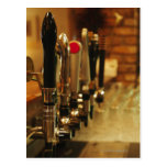 Close-up of beer taps in bar 2 post card
