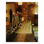 Close-up of beer taps in bar 2 posters